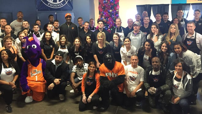 Phoenix Suns staff and former players help serve food to the needy at St. Vincent de Paul Wednesday Nov. 23, 2016 in Phoenix, Ariz..Credit: Marissa Roper