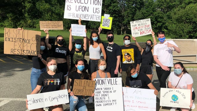 Students and graduates of Montville Township High School came together to march for police reform and a restructuring of the school's curriculum on African American history.