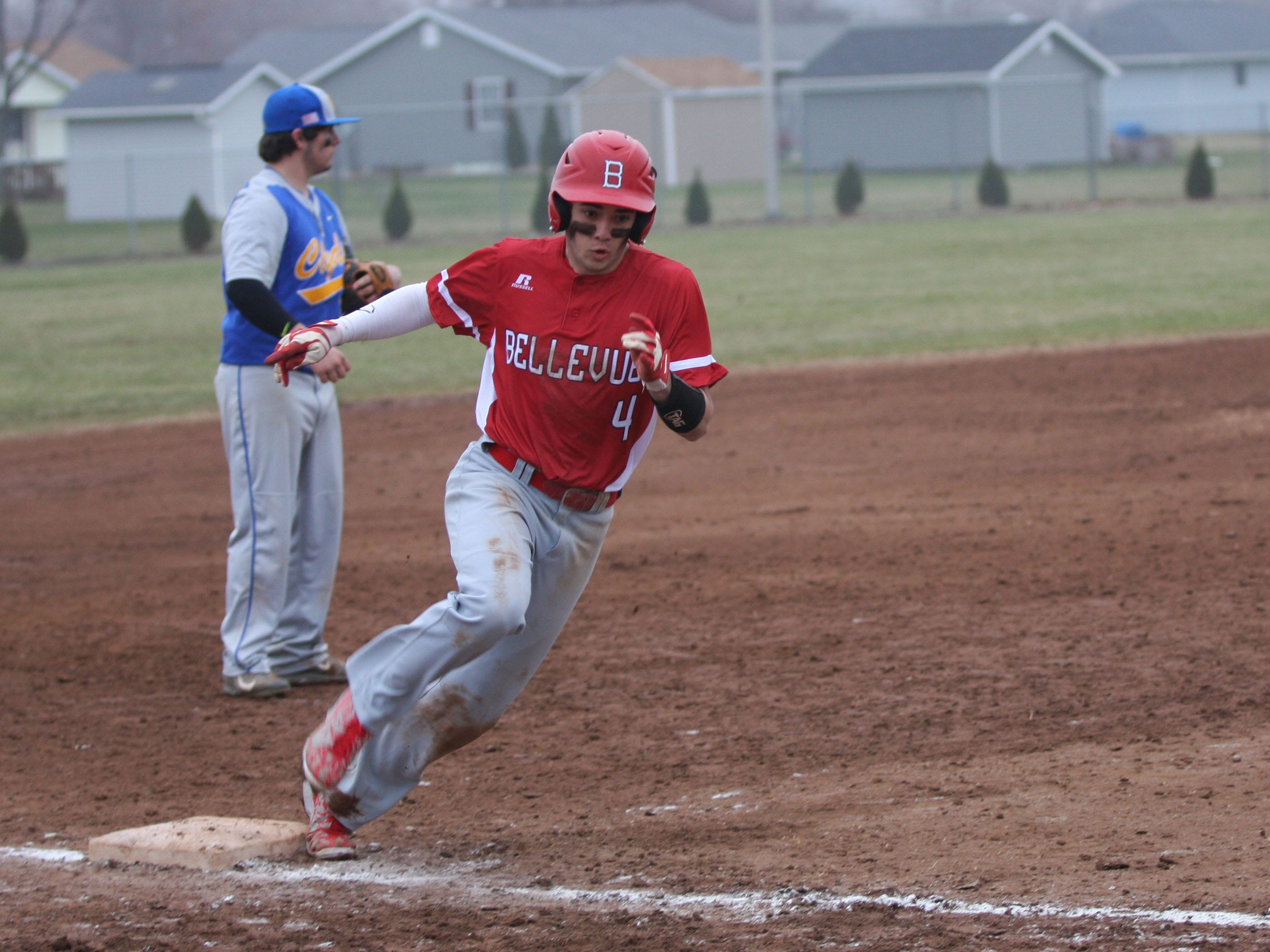 Bellevue's Grant Vickery rounds third to score the go-ahead run in the top of the seventh inning Wednesday against Clyde.