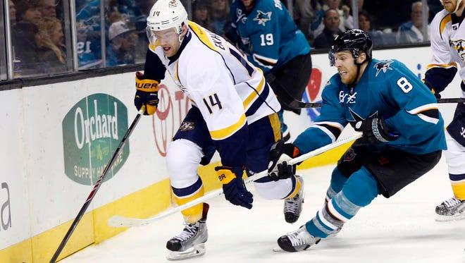 San Jose Sharks center Joe Pavelski (8) chases down Nashville Predators defenseman Mattias Ekholm (14) during the second period behind the Predators net at SAP Center at San Jose.