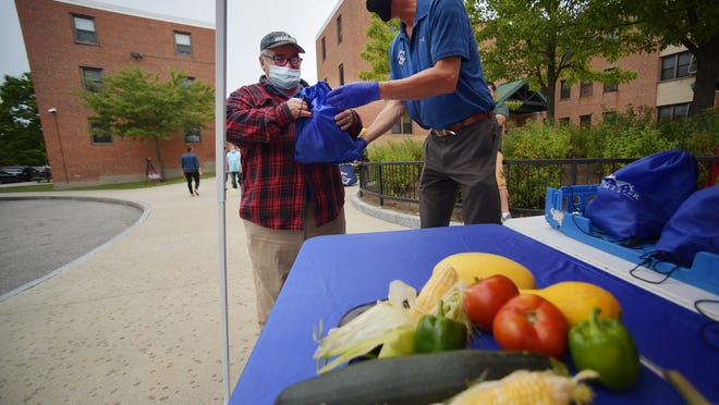 WORCESTER - Worcester County Sheriff Lew Evangelidis has partnered with the Worcester Housing Authority and donated fresh organic produce to residents at Great Brook Valley. The sheriff is shown on Thursday.