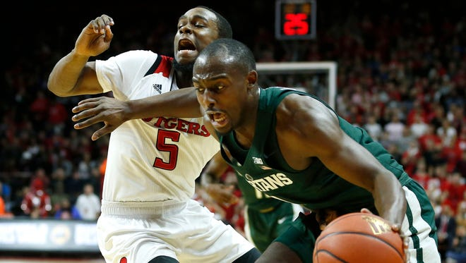 Rutgers Scarlet Knights guard Mike Williams (5) defends against Michigan State Spartans guard Joshua Langford (1) during first half at Louis Brown Athletic Center.