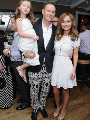Giada De Laurentiis and Todd Thompson attend the Italian in Paradise dinner hosted by Giada De Laurentiis during the Food Network South Beach Wine & Food Festival at Casa Tua on February 21, 2014 in Miami Beach, Florida. The Food Network star says she is splitting from fashion designer Todd Thompson, her husband of 11 years.