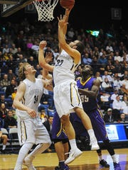 Augustana's Casey Schilling (32) goes up for a shot during a game against Minnesota State University, Mankato Friday, Dec. 4, 2015, at the Sioux Falls Arena in Sioux Falls.