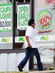 A person enters the PL$ Loan Store located at 2010 Red Arrow Trail. photo by Mike DeVries A customer enters the PL$ Payday Loan Store on Red Arrow Trail in Madison, Wis. In 2015, the average annual interest rate on payday loans in Wisconsin was 565 percent.