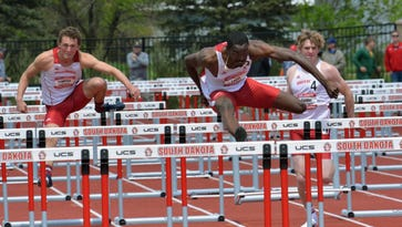 Teivaskie Lewin (center) is the 10th-ranked qualifier in the 110-meter hurdles going into the NCAA Championships.