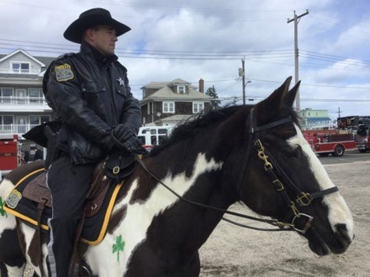 Ocean County Sheriff's Officer Brian Stockhoff rides Sambuca at the Ocean County St. Patrick's Day Parade in Seaside Heights.