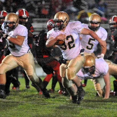 Lancaster's Shea Goss looks for the end zone Friday night, Oct. 2, 2015, in Groveport. The Gales won the game to remain undefeated on the season.