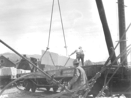 Historic photo of a railroad car being loaded at the quarry.
