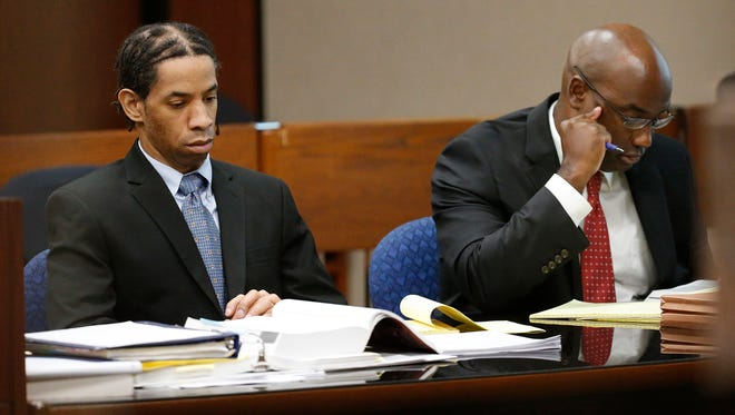 Carlos Antonio Holcombe, left, is shown at his trial in the kidnapping and sexual assault of a 12-year-old girl who was attending a football scrimmage game in August 2014 at Horizon High School. He was sentenced to life in prison after being found guilty.