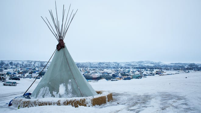 A teepee stands on the side of a hill overlooking in the Oceti Sakowin Camp near the Standing Rock Reservation on Saturday, Dec. 3, 2016, near Cannon Ball, N.D.