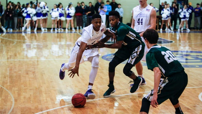 January 13, 2017 - William Douglas drives the ball towards the hoop during the first half of Friday night's game at Christian Brothers High School.