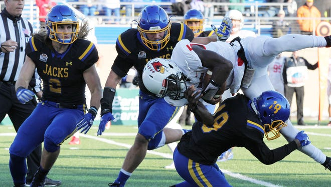 Illinois State's Malachi Broadnax (5) dives for another yard over South Dakota State's Marshon Harris (18) during the second quarter of the Redbirds' football game against South Dakota State Saturday afternoon in Brookings, SD.