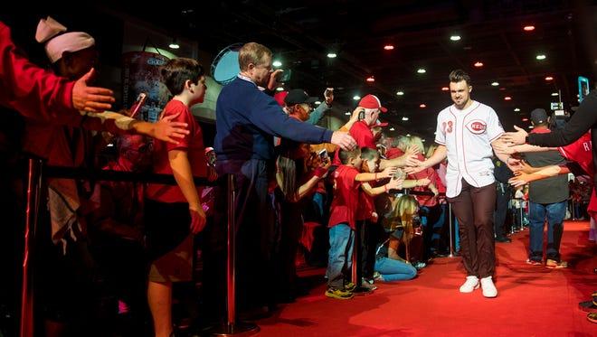 Cincinnati Reds left fielder Adam Duvall (23) greets fans at Redsfest at the Duke Energy Convention Center in downtown Cincinnati Friday, December 1, 2017.