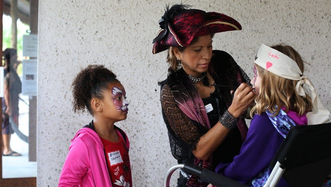 File: Ava Lewis, 7, watches as Silvia Zavala paints a butterfly onto her best friend Alexis Malloy's face at the 3rd Annual Pirate Day at the Marco Island Historical Museum on Jan. 24, 2015.