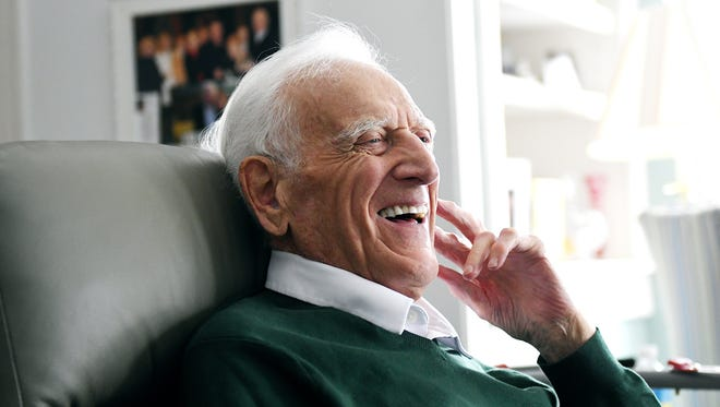 Former Michigan State University men's basketball head coach and color commentator for MSU basketball broadcasts Gus Ganakas laughs while reflecting on his time at Michigan State University on Thursday, March 8, 2018, at his home in East Lansing.
