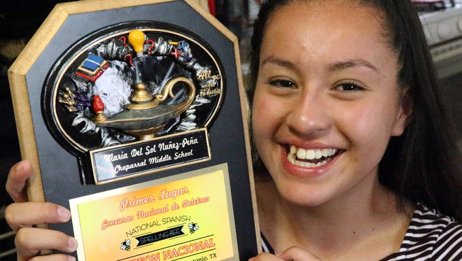 Maria Del Sol Nuñez Peña, who will be a freshman at Chaparral High School, shows a special plaque made for her by Chaparral Middle School for placing first nationally in the National Spanish Spelling Bee on July 15 in San Antonio.