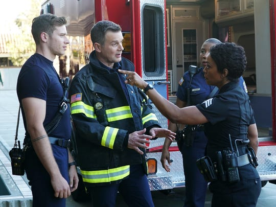 "Angela Bassett as Athena Grant, Peter Krause as Bobby Nash and Oliver Stark as Evan ""Buck"" Buckley on ""9-1-1."""