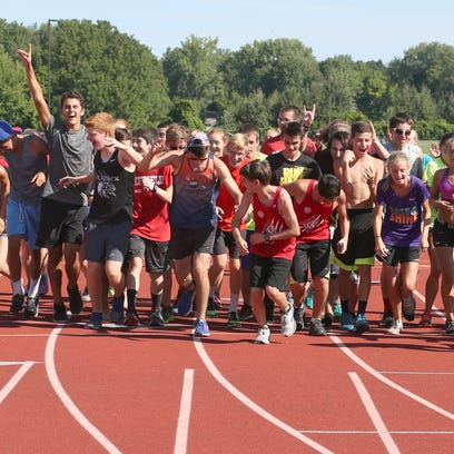 The entire Penfield cross country team run across the