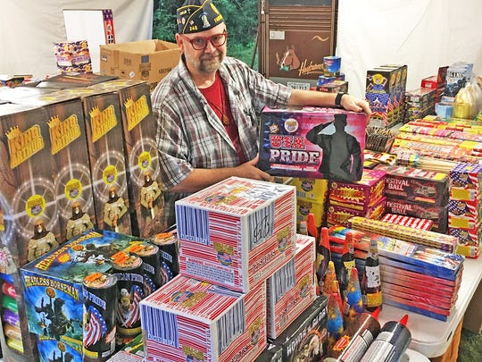 Fairview American Legion Chaplain Brian Hendrix displays the large assortment of fireworks available at their second annual Fireworks Tent Sale in the parking lot at Farm Fresh Vintage Finds, 1861 Fairview Blvd.