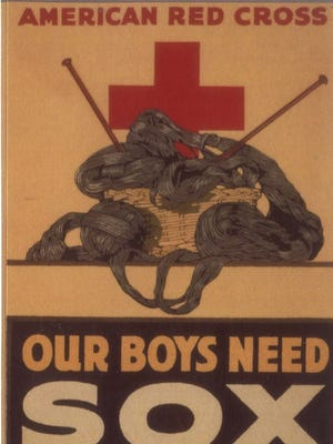 """An American Red Cross poster asking people to """"Knit Your Bit,"""" as in knit supplies, including socks, for the American troops on the front line."""