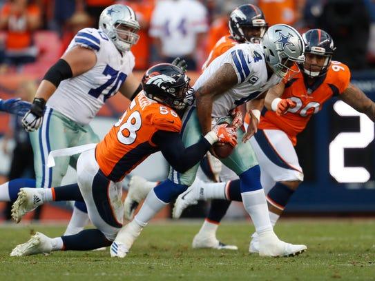 Denver Broncos outside linebacker Von Miller (58) sacks