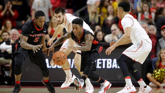 Rutgers guard Mike Williams, Maryland forward Ivan Bender, Rutgers guard Nigel Johnson and Maryland guard Jaylen Brantley, from left, chase a loose ball.