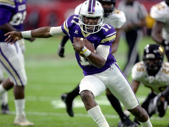 Alcorn State quarterback Lenorris Footman (17) carries