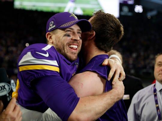 FILE - In this Jan. 14, 2018, file photo, Minnesota Vikings quarterback Case Keenum, left, celebrates after a 29-24 win over the New Orleans Saints during the second half of an NFL divisional football playoff game in Minneapolis. Keenum replaced an injured Sam Bradford, who had replaced an injured Teddy Bridgewater, all three of whom have expiring contracts after the Super Bowl. (AP Photo/Jeff Roberson, File)