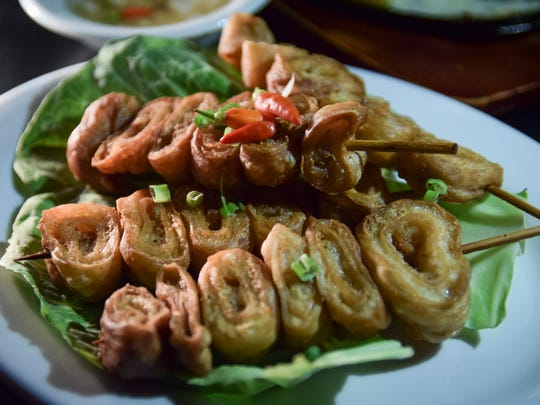 A plate of isao, or fried intestines, is served on skewers at V-Keys Lounge & Restaurant in Tamuning on Oct. 31.