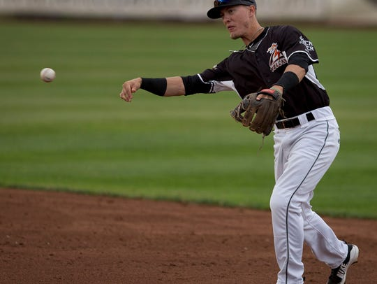 Volcanoes infielder Kyle McPherson, (2), makes a throw