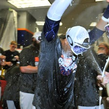 Victor Martinez celebrates with Justin Verlander, right, after the Tigers clinched their fourth straight AL Central championship.