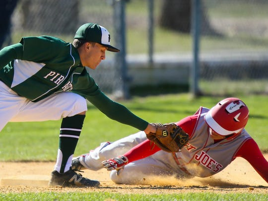 St. Joseph's John Payne slides safely into third base during a 6-2 win over Cedar Creek on April 5.