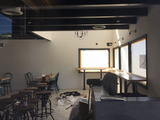 A dining counter has been installed in the windows