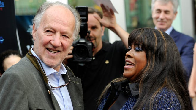 """Director Werner Herzog, left, greets Chaz Ebert, widow of the late film critic Roger Ebert, Thursday, at the premiere of the documentary film """"Life Itself"""" on Thursday, in Los Angeles."""