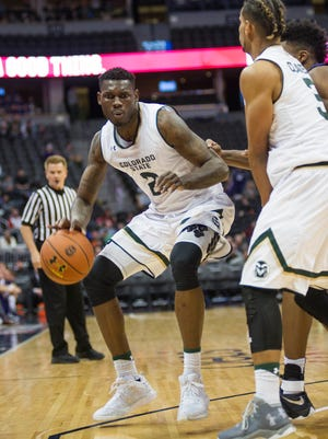 Emmanuel Omogbo, CSU's leading scorer and rebounder, drives around a screen set by teammate Gian Clavell during a Dec. 17 loss to Kansas State at the Pepsi Center in Denver. The Rams open Mountain West play at home Wednesday night against UNLV.