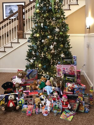 A Christmas tree located in the plaza of Mirador, a retirement community, quickly became surrounded by toys residents had donated to Toys for Tots for children in their community.