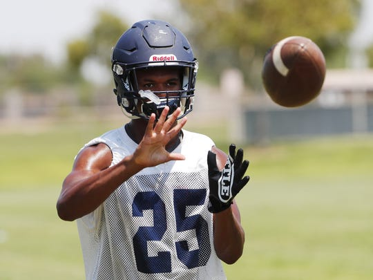 RB Peyton Hill catches a ball during practice in Gilbert August 1, 2018.