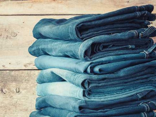 A stack of denim jeans.