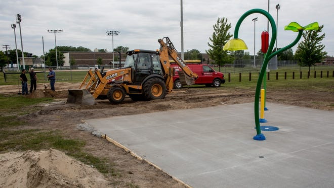 Construction of a splash pad is underway Friday, June 9, 2017 at Knox Park in Port Huron.