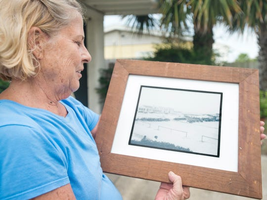 Lea Fillingim Blackwell shows a picture of the Casino that once stood near what is now called Casino Beach as she talks about growing up on Pensacola Beach.  Wednesday, August 17, 2016.  Lea grew up in a house built by her father on Maldonado Drive and currently lives a couple doors down in the first house built by her father in the early 1950's. The Casino (a community recreation complex that featured a dance pavilion, bath houses, shops and a restaurant on Santa Rosa Island) stood from 1931-1972.