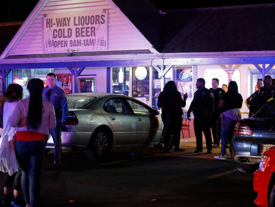 Wilmington, New Castle County and Delaware State Police control the scene in the aftermath of a shooting at the Shades of Blue nightclub on Gov. Printz Boulevard in April 2016.