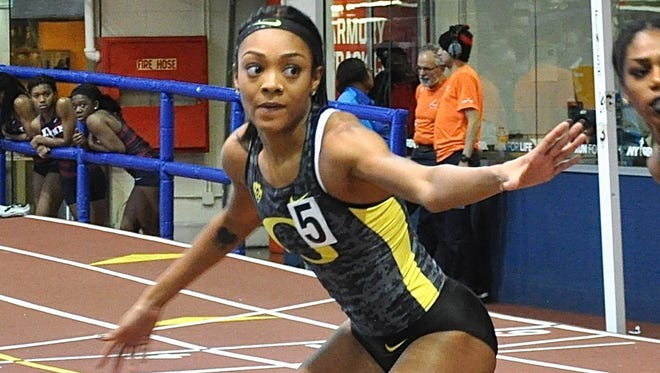 Oregon's Deajah Stevens, who lives in Tarrytown when not at school, prepares to take the baton during the women's 4x400 relay..