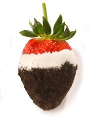 A white Oreo chocolate dipped strawberry from Rocky Mountain Chocolate Factory