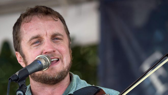 Louis Michot of Lost Bayou Ramblers entertain Thursday at Feed N Seed in downtown Lafayette.