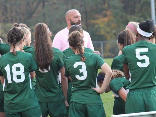 Sycamore girls soccer coach Brian Fallon speaks to