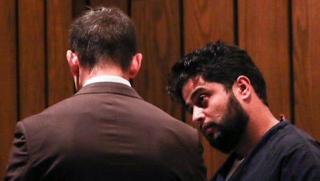 Anwar Ghazali, right, and his attorney, Blake Ballin, talk before the start of Ghazali's preliminary hearing on April 26, 2018.