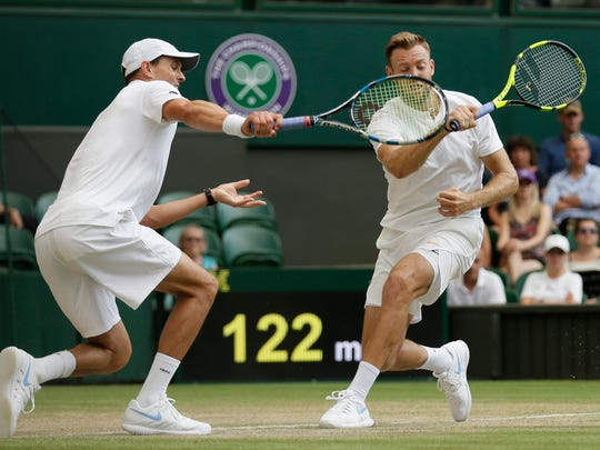 Camarillo's Mike Bryan, left, and Jack Sock hit their