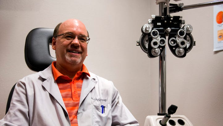 Optometrist Dr. Greg Ray poses for a portrait in a