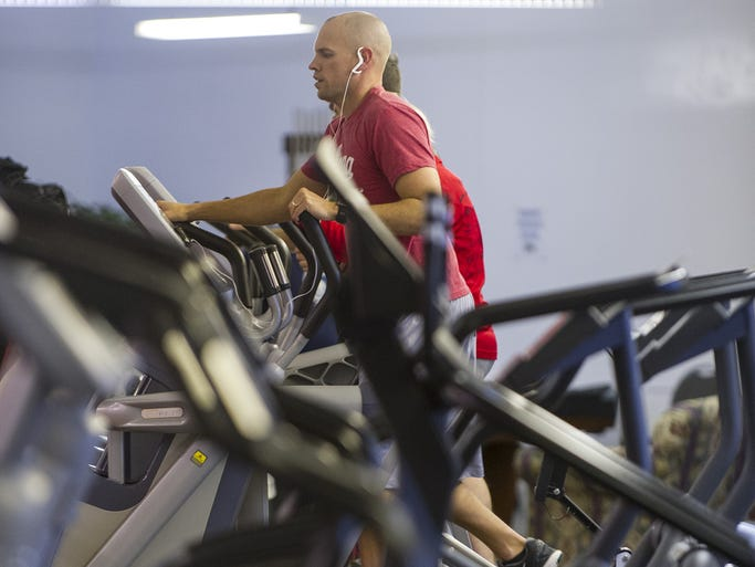 The fitness equipment at Greenwood Community Center is actively used Friday, January 3, 2014.